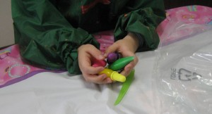 Geleez Pens in child's hands for scale