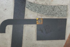 This is a clock embedded into the walkway outside Fairfield Library.